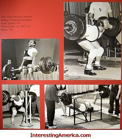 """THIS DISPLAY AT THE USA WEIGHTLIFING HALL OF FAME READS, """"THE FIRST WORLD POWERLIFTING CHAMPIONSHIPS TOOK PLACE ON NOVEMBER 6, 1971 IN YORK, PA."""" (PHOTO © RICHARD GRIGONIS)"""