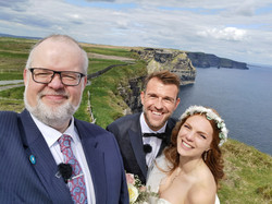 Couple with their Humanist Celebrants at The Cliffs of Moher