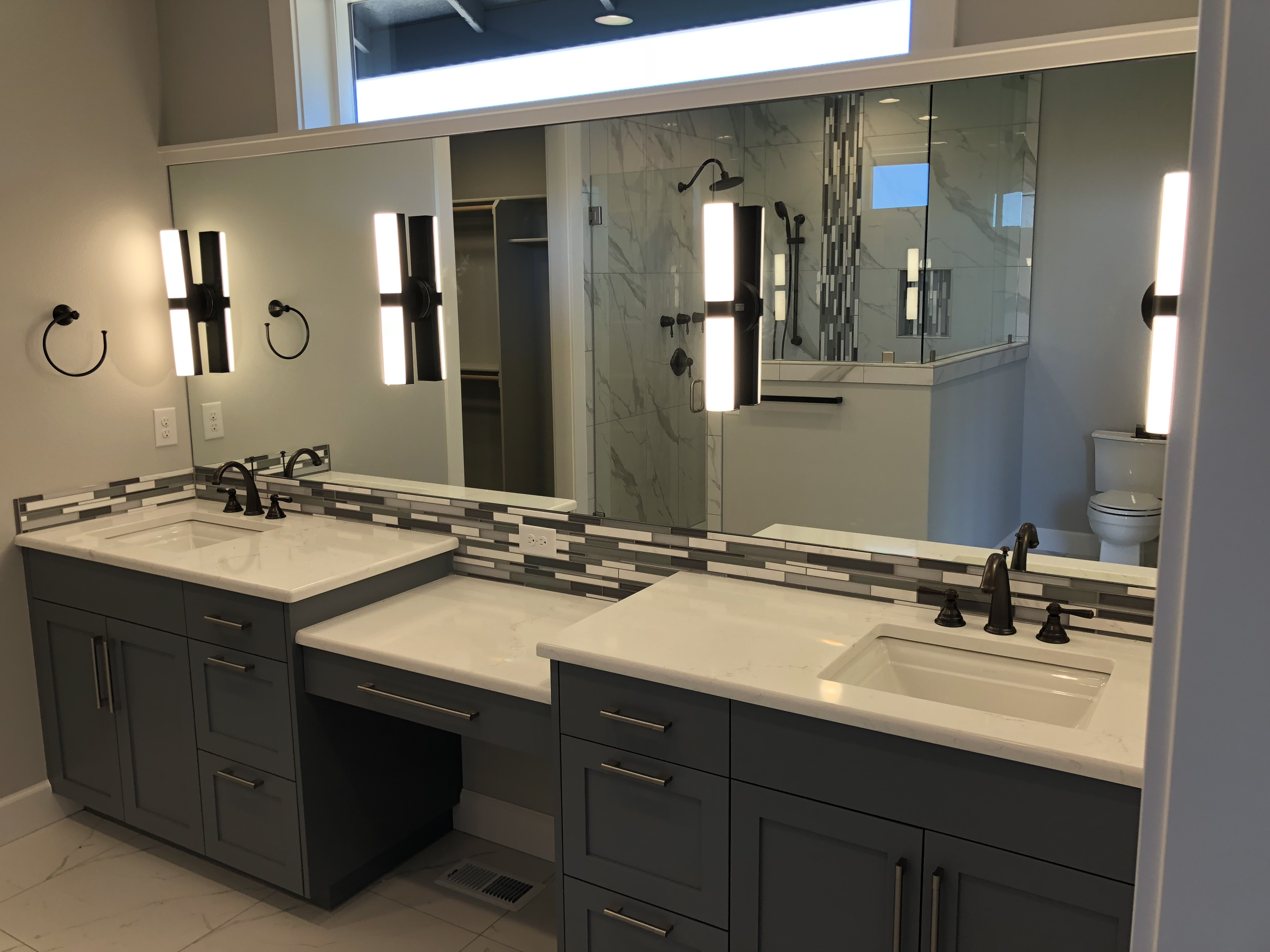 Bathroom view with cabinets front view