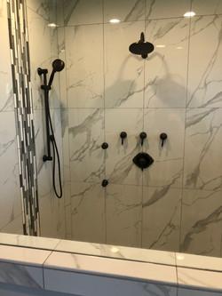 View of glass shower looking closer thru