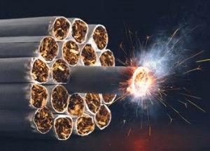imagem de vários cigarros organizados como uma dinamite, representando o perigo do fumo