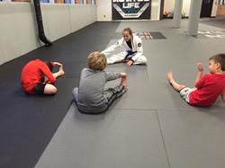 brianna-teaching-kids-jiu-jitsu