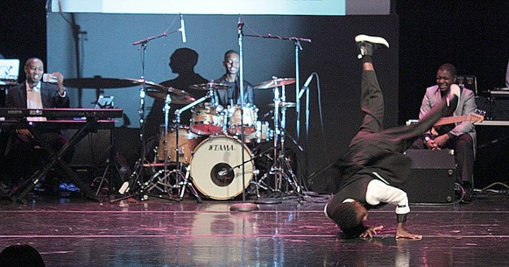 John Thekidstar show his break dancing skills #Recap the 6th Annual Black & White Ball and #BUZZZINO