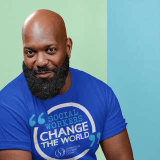 t-shirt-mockup-of-a-bald-bearded-man-sit