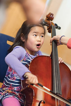 Child in New Haven learning to play an instrument through local lessons
