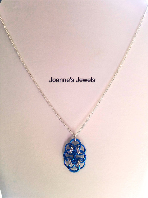 Blue Lapis and Silver Elongated Roses of Success Pendant