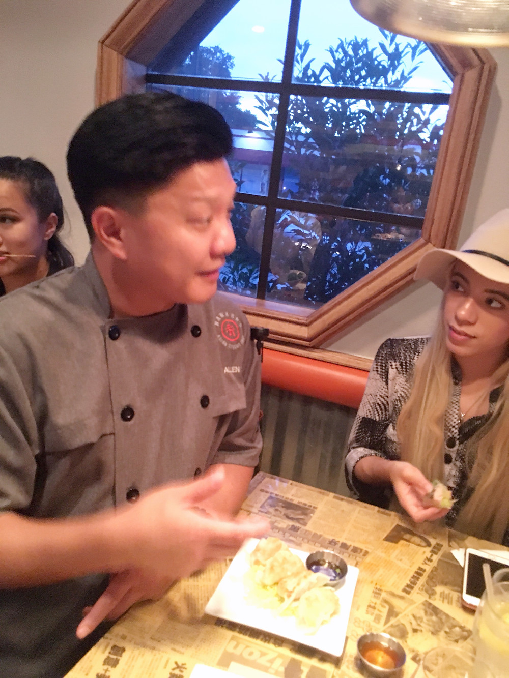 Orlando-food-blogger-Katrina-Belle-listens-to-Chef-Allen-Lo-at-Hawkers-Orlando-Asian-Street-Food-Mills-50-District-Orlando-Fashion-Blogger-celebritychef4u