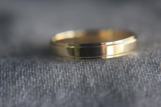 The Flattened Edge Wedding Ring
