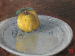 Yellow Apple on a Plate