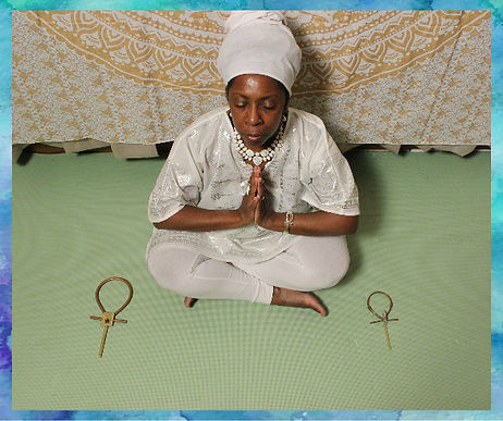 queen Mother Imakhu in prayer-blue borde