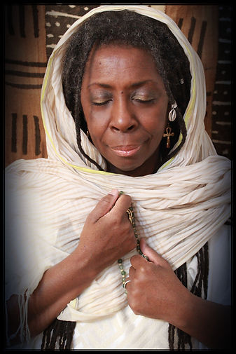 Queen Mother Imakhu in prayer shawl with