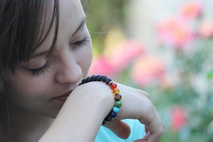 Girl smelling bracelet.jpg