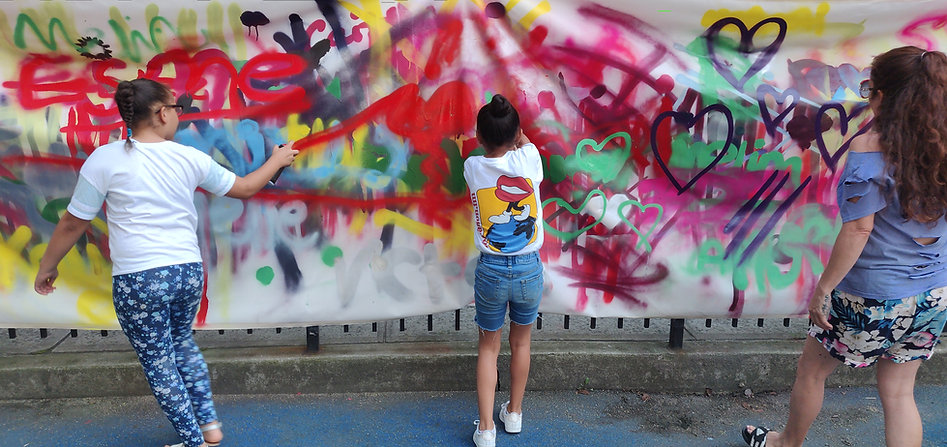 Children spray painting - photo credit Jess Rolls