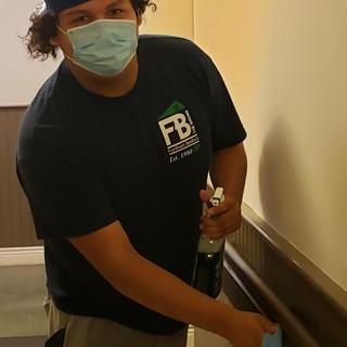 Staff member sanitizing
