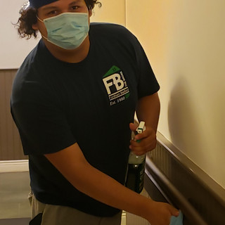 Staff member sanitizing