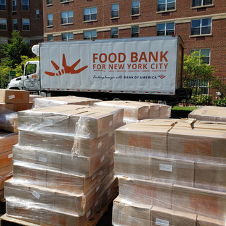 Food Bank truck and pallets of food boxes