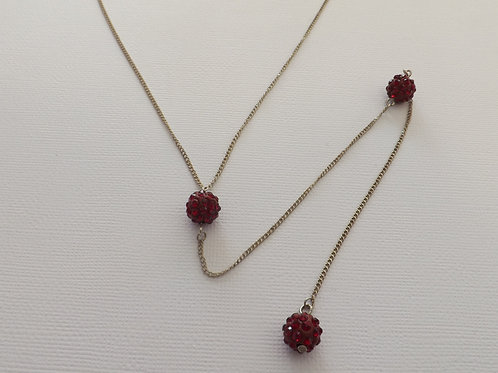 Silver Y necklace with red disco ball beads