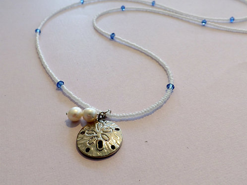 White seed bead necklace with sand dollar charm