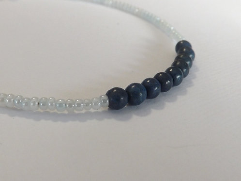 White seed bead bracelet with 9 dk blue jade beads