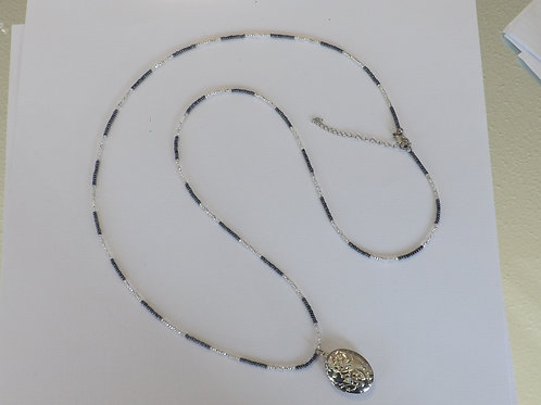 Hematite and clear bead necklace with oval locket