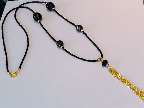 Black bead necklace with gold