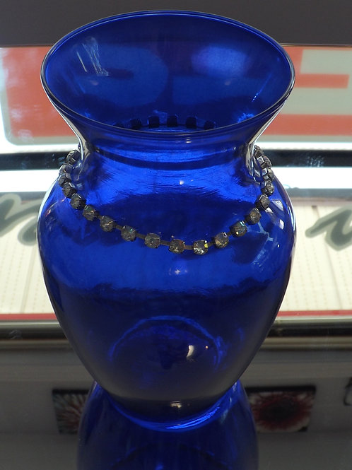 Blue glass vase with rhinestone around neck