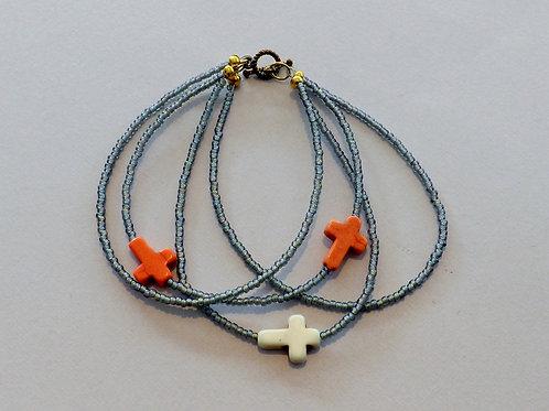 Triple strand grey bead bracelet with 3 crosses