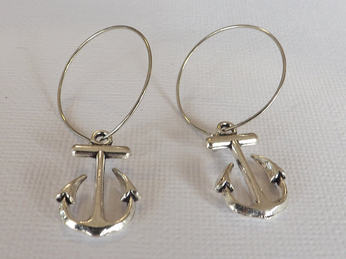 Silver hoop earring with sea themed charm