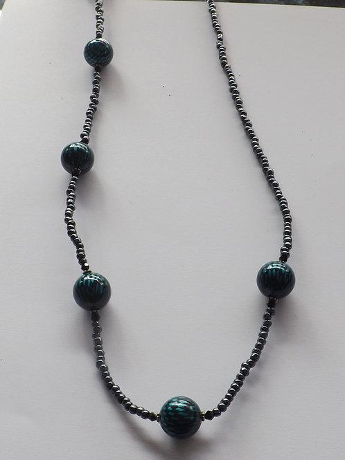 Hematite bead necklace w/large teal & black bead
