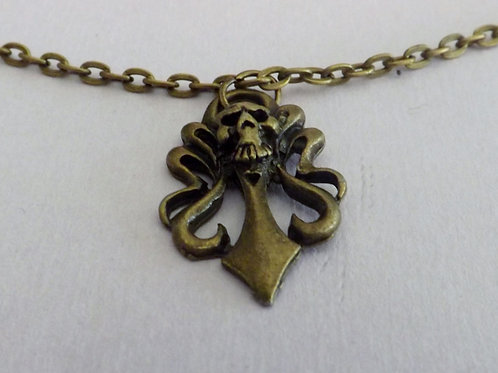 Antique bronze chain necklace with skull charm