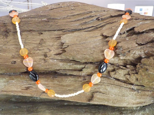 Beaded necklace - Orange, beige, and black glass