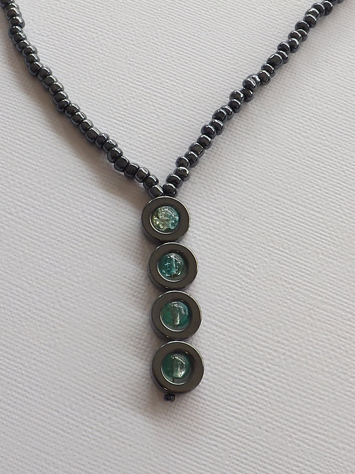 Hematite bead Y necklace w/cracked glass green