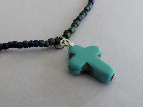 Beaded necklace with turquoise carved stone cross
