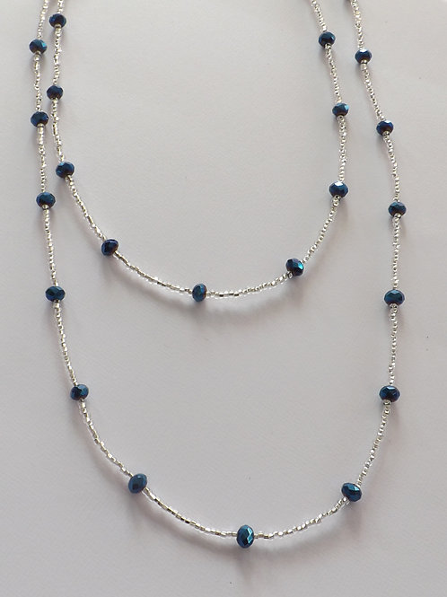 Clear beaded necklace w/blue faceted beads