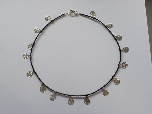 Black bead necklace with silver teardrops