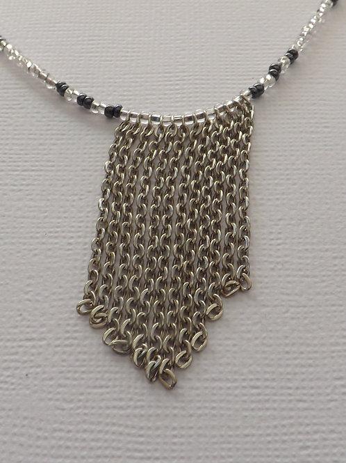 White & hematite bead necklace with chain bib