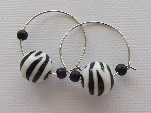 Silver hoop with zebra striped bead