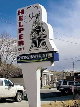clock sign, neon sign, pylon sign