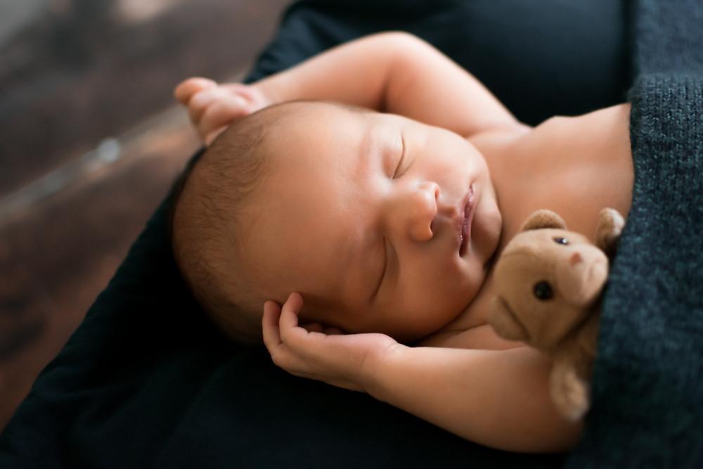 Newborn baby boy photography session in Burnsville Minnesota with mini teddy bear