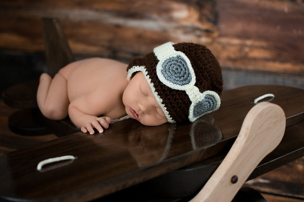 Newborn baby boy photography session with wooden airplane in Burnsville Minnesota