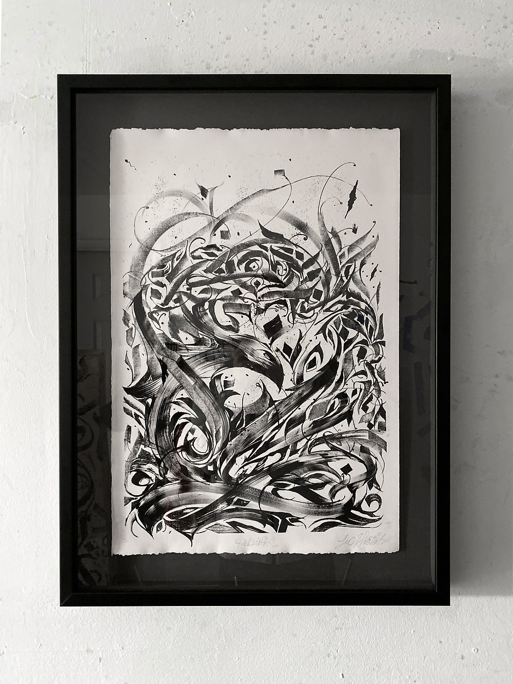 "Rebirth - Lithography Print on Archival Paper 19""x13"" This piece was my first exploration into lithography printing. I worked with the image of a phoenix and was interested in exploring the ideas of rebirth and cycles through an abstracted mandala ring around the phoenix."