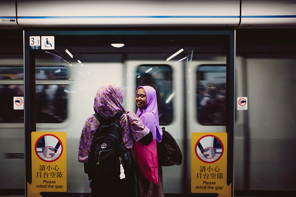 Domestic helpers waiting inside the subway during rush hours after the only day off over a week