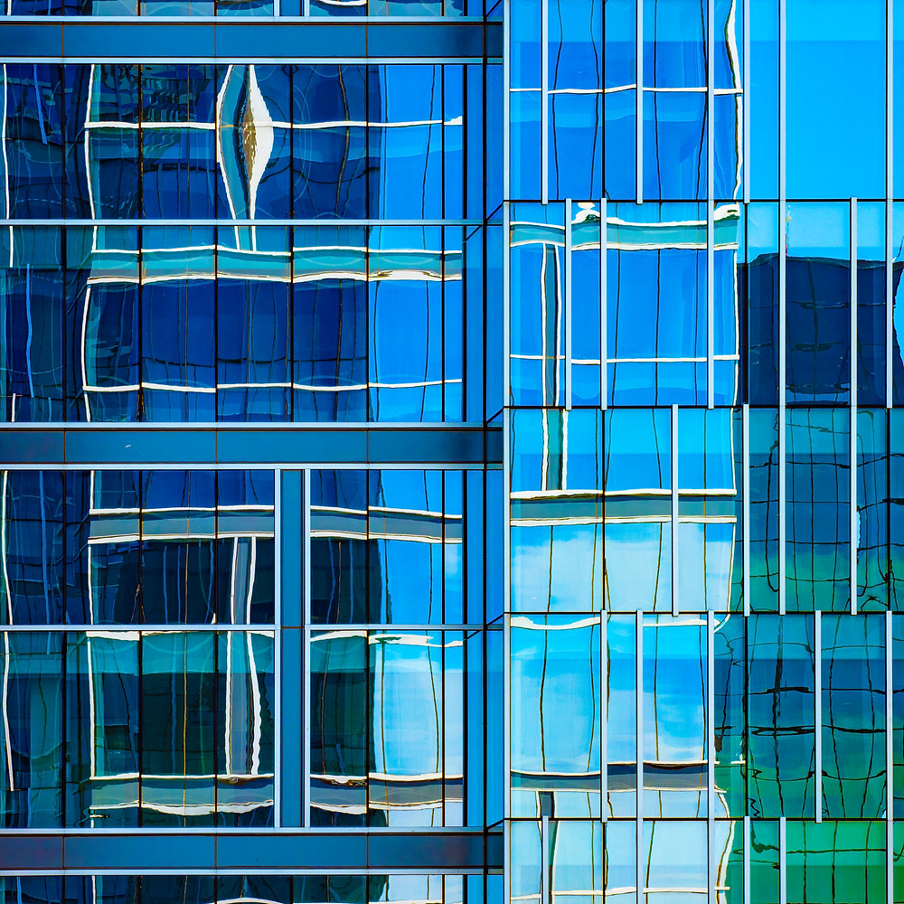 Office building in Bloomington Minnesota. It is part of a small complex of similarly designed structures with mirrored facades. What makes them fascinating is the reflective interactions between the buildings.   Taken with an Olympus E-M1 Mark II, the 12-100 f4 Pro lens,