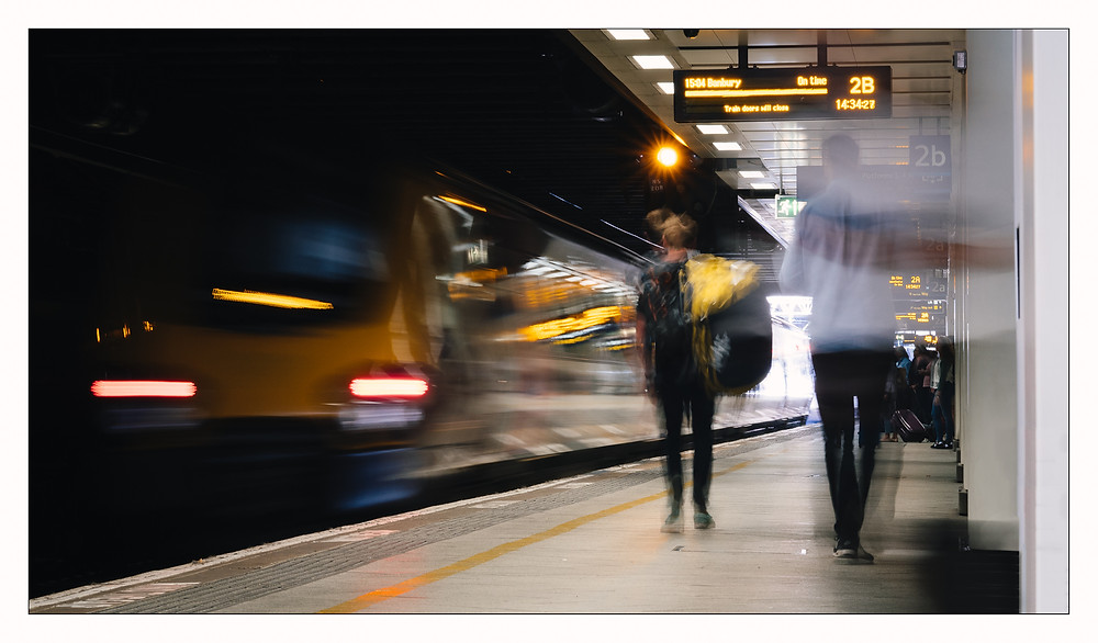 Voyager Arrival - Motion blur from train and passengers at Birmingham New Street Station.