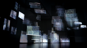 """If time is a shared scale of measurement, every phenomenon occurring on that time axis (timeline) should exist simultaneously as overlapped layers that continue to occur on various scales even at this very moment. In this piece of work, finely-cropped, abstract images are projected all at the same time using multiple projectors, and are reflected with a certain depth on the transparent screens laid out three-dimensionally. The idea is that all states can exist concurrently as generation and disappearance repeat themselves.This work was exhibited at an underground art space at Hilton Tokyo for """"Shinjuku Creators Festa 2017""""."""