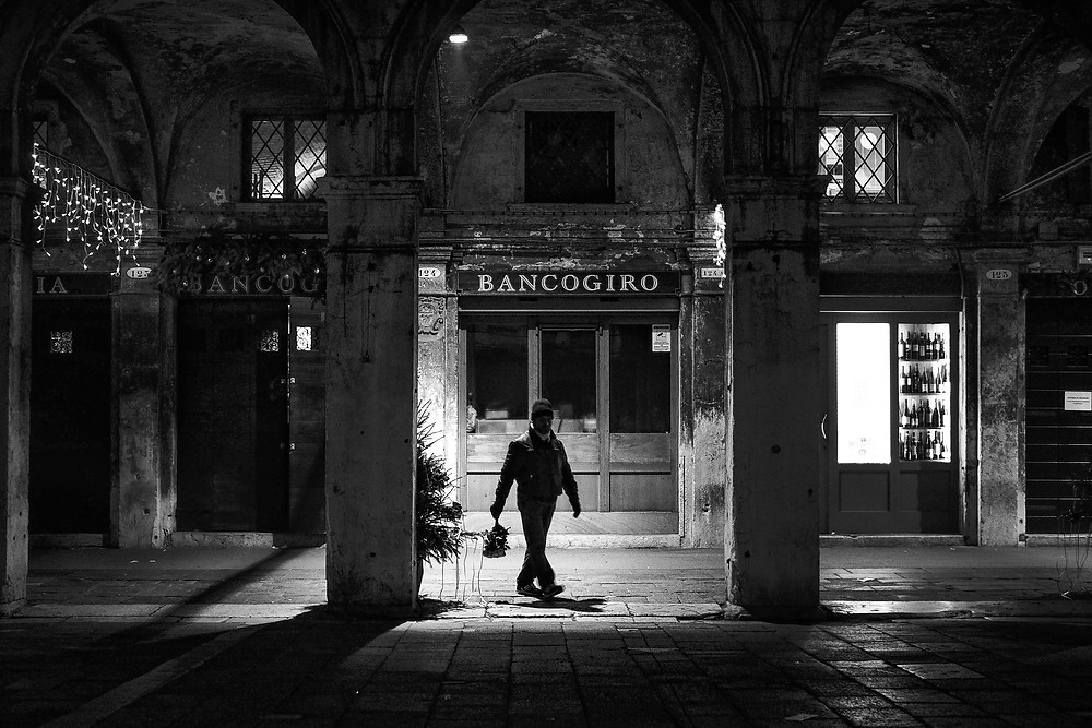 Venezia:  THE ROSE SELLER - taken in the late evening in front of a restaurant near the fish market.