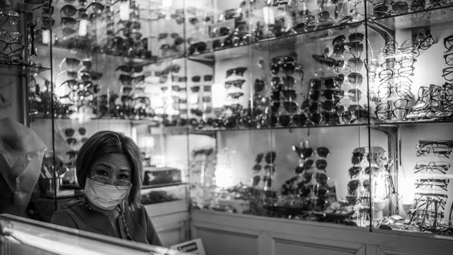 Regardless of the risks posed by the CONVID-19 virus this eyewear vendor exercises precaution by wearing a mask.