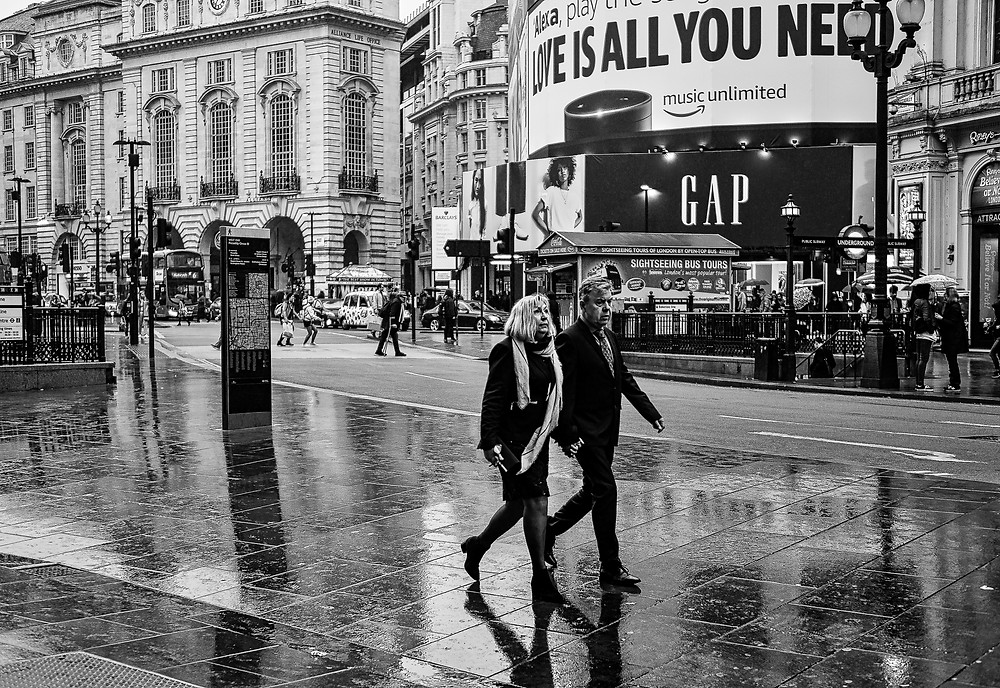 London:   LOVE IS ALL YOU NEED - the perfect moment when the hands-holding couple corresponded with the changing billbord.