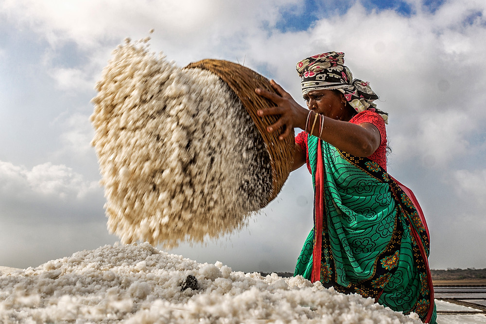 This pic was taken at the salt field in Gujarat India. A candid moment of their working.