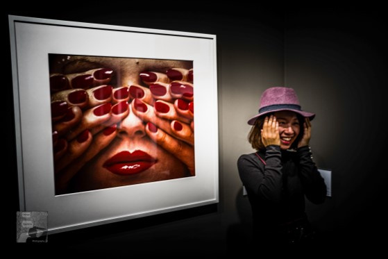 Nail it. This is a digital photograph taken during Paris Photo 2017. The famous photograph by Guy Bourdin was on the show and I got the candid moment.